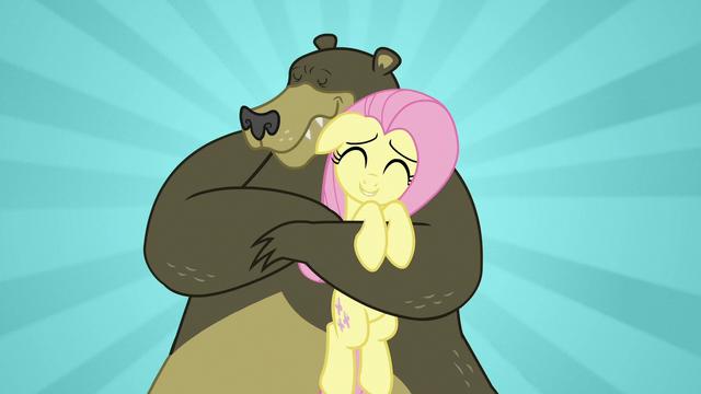 File:Fluttershy getting a warm bear hug S7E2.png