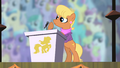 Ms. Harshwhinny at the podium S4E05.png