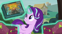 Starlight holding a copy of Dragon Pit S8E19