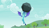 Ember holding a boulder over her head S7E15