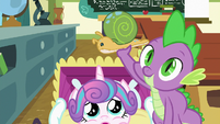 Spike holding Flurry Heart's Whammy toy S7E3