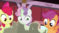 Sweetie Belle excitedly opens the package S8E10