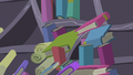 Books and scrolls pulled toward the black hole S7E1.png