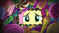Fluttershy looks inside her candy bag S5E21