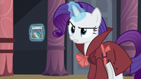 Rarity levitates a piece of Rainbow's mane S5E15
