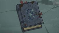Star Swirl's journal on the rock pedestal S7E25