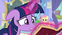 Twilight desperately looks through a book S9E25