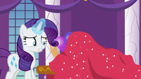 Rarity puts new tablecloth on top of Spike S9E13