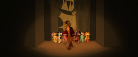 Capper guiding the ponies through town MLPTM