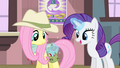Rarity levitating a wrap into Fluttershy's saddlebag S4E11.png