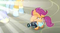 Scootaloo shields her eyes from the blinding light S7E7