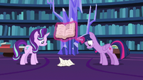 Twilight and Starlight look at crumbling pages S7E14