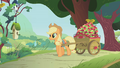 Applejack pulling a cart filled with apples S1E10.png