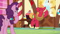 Big Mac leans against the bakery door S8E10.png