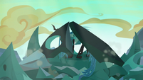 Queen Chrysalis emerging from the hive rubble S6E26