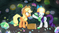 Rarity pushing Applejack's lantern away S9E19