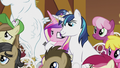 Shining Armor with hoof around Cadance S5E9.png
