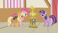 Applejack and Pinkie gazing at the trophy S1E04.png