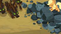 Applejack pushing boulder on timberwolves S03E09
