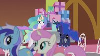 Celestia looking at ponies trotting past S5E9