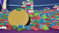Mess of library books and table S6E21.png