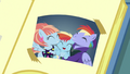 Photo of Baby Rainbow and her parents in Scoot's scrapbook S7E7.png