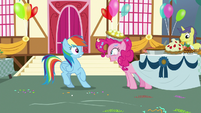Pinkie Pie pops out from under a table S7E23