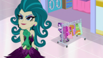 Starlight Glimmer sneaking next to a clothes rack EGS3