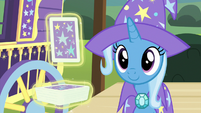 Trixie looking at the ace of clubs S7E24
