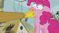 Gilda puts a scone into Pinkie's mouth S5E8.png