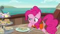Pinkie inspecting a cucumber sandwich S6E22.png
