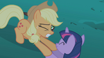 Applejack grasping Twilight's hooves S1E02