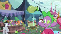 Spike looking at the chaotic marketplace S9E23