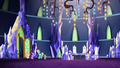 Twilight, Fluttershy, Spike, and Zephyr in the wide throne room S6E11.png