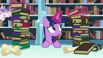 Twilight levitates one of the books S6E2