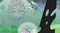 Ponies and creatures charge down the hill S9E25