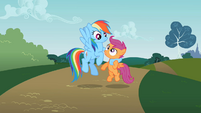 Rainbow Dash holding Scootaloo S2E08