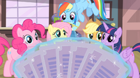 Rarity's friends looking at the tickets S4E08