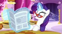 Rarity reads --some might say it's the ultimate achievement in Equestrian fashion-- S6E9