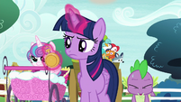 Twilight Sparkle looks at a pocketwatch S7E3