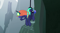 Luna hangs bored from climbing rope S9E13