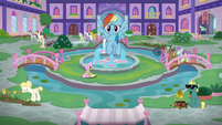 Rainbow flying into the school courtyard S8E9