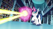 Shining Armor conjures a shield to deflect the magic beam S6E2