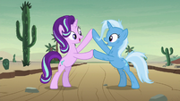 Starlight and Trixie touching hooves S8E19