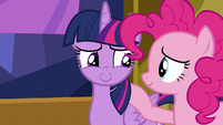 Twilight Sparkle smiling at Pinkie Pie S7E14
