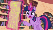 Twilight pointing at a drawing of her S4E21
