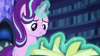 Starlight Glimmer flips through book pages S6E21