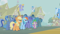 The ponies stare at a triumphant Trixie S1E06