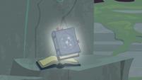 Image of Star Swirl's journal falls to rock pedestal S7E25