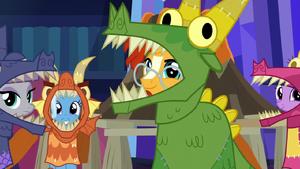 Maud, Trixie, Sunburst, and Twilight in dragon costumes S7E24